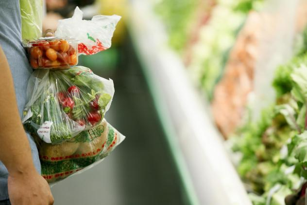 A shopper holds fresh produce at Northgate Gonzalez Market before a news conference there, where the Los Angeles County Department of Public Health announced new data on food insecurity in the county, in September 2017. Food insecurity affected 1 in 3 lo