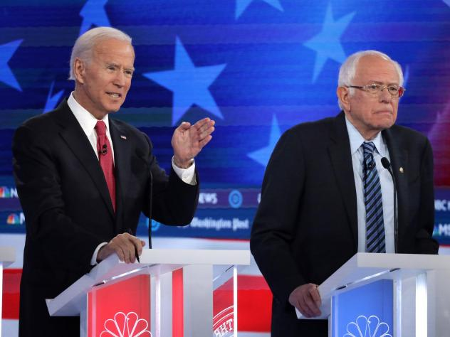 Former Vice President Joe Biden (left) and Sen. Bernie Sanders lead the crowded Democratic presidential primary field, according to the latest NPR/<em>PBS NewsHour/</em>Marist Poll. Above, they appear during the Democratic presidential primary debate in