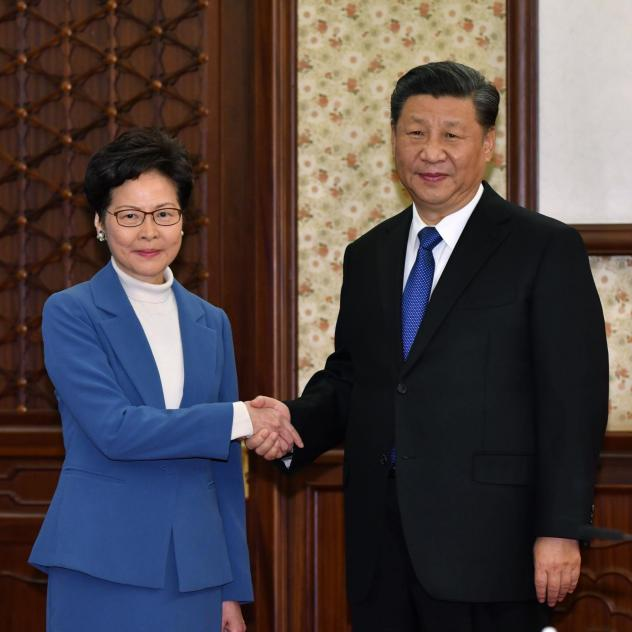 Hong Kong Chief Executive Carrie Lam shakes hands with Chinese President Xi Jinping in a gesture of solidarity Monday in Beijing.