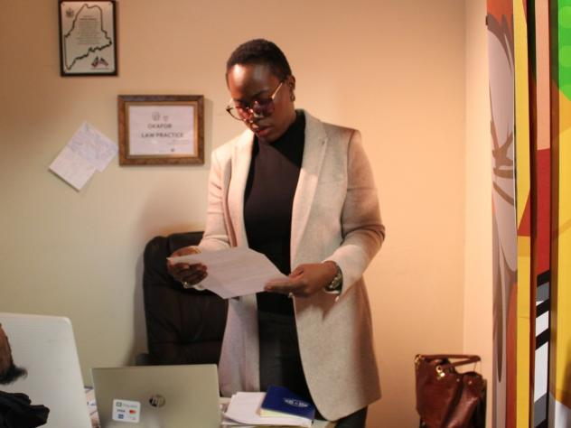 Angela Okafor at her small immigration law office located inside her store in Bangor, Maine. Okafor, who has a law degree from her home country of Nigeria and passed the New York bar exam, opened an immigration law practice three years ago.