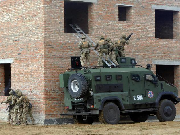 Soldiers storm a building during a drill held as part of the Exercise Rapid Trident 2019, an annual multinational training exercise near Yavoriv, Ukraine.