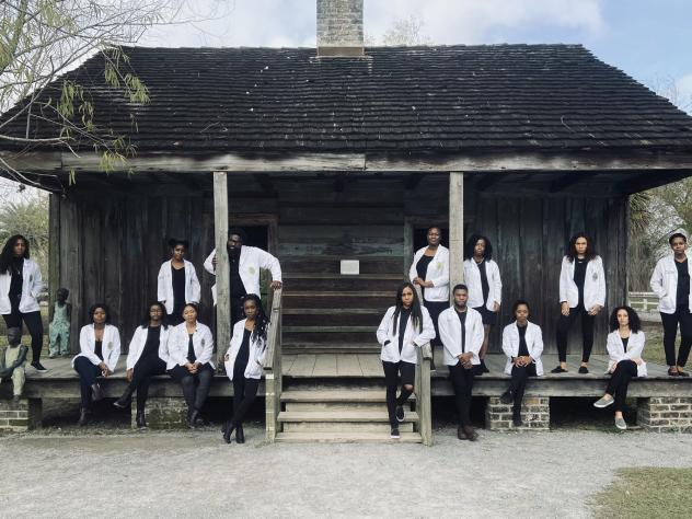 "Russell Ledet, a second-year medical student (top row, third from left) organized an outing for 14 of his fellow African American classmates to a former plantation that had slave quarters. Ledet says he would caption this photo ""Our Moment of Resiliency."