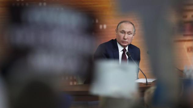 "Russian President Vladimir Putin speaks Thursday during his annual news conference in Moscow. During the four-hour session, the longtime Russian leader called the U.S. impeachment process ""far-fetched,"" making the prediction that Donald Trump will be acq"