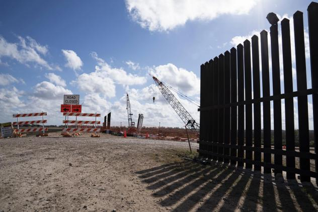 The existing border wall (right) is seen near the construction site of new wall panels south of Donna, Texas, on Nov. 20. There is widespread skepticism on the border that President Trump will get anywhere near the 450 miles of wall he wants by next Nove
