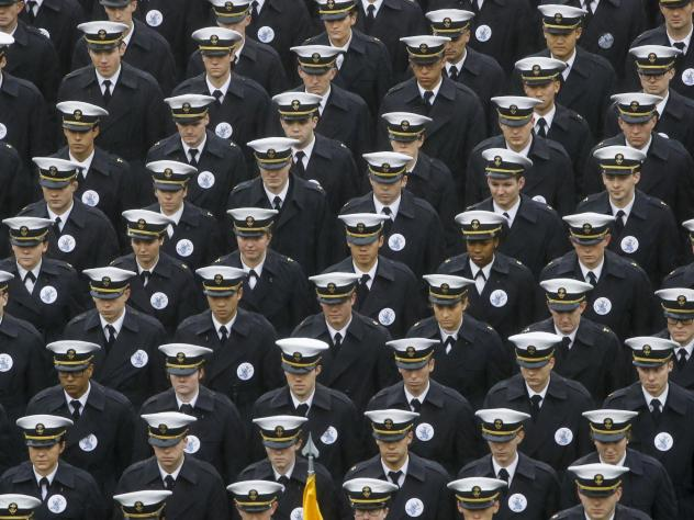 Navy midshipmen march onto the field ahead of the annual NCAA college football game between the Army and the Navy in Philadelphia on Dec. 14.
