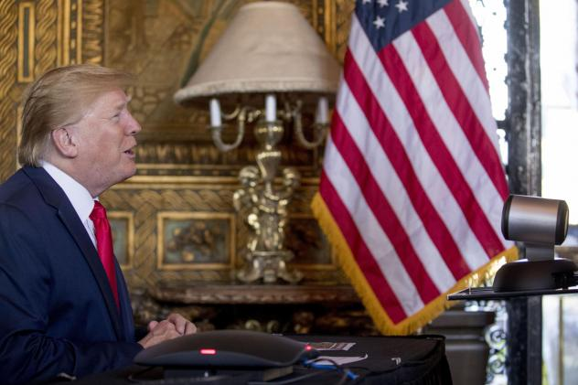 President Donald Trump speaks during a Christmas Eve video teleconference with members of the military at his Mar-a-Lago estate in Palm Beach, Fla.