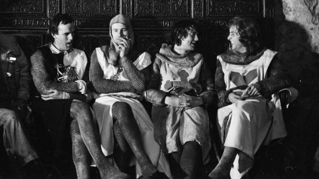 From left to right: John Cleese, Neil Innes, Michael Palin and Eric Idle dressed as Arthurian knights on the set of <em>Monty Python and the Holy Grail </em>in 1974.