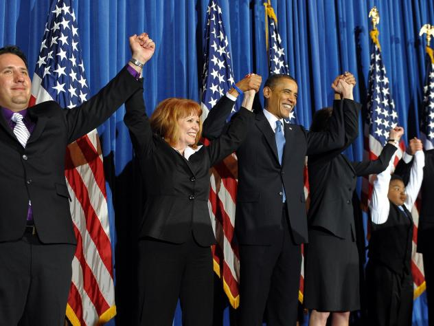 President Barack Obama celebrates with lawmakers after signing into law the Patient Protection and Affordable Care Act health insurance bill in March 2010.