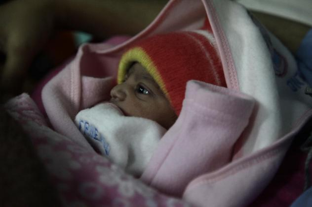 A 5-pound newborn girl is swaddled in a blanket in a hospital in Islamabad, Pakistan. She was born on Jan. 1, 2020.