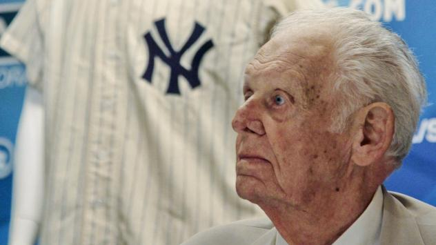 In this photo from June 28, 2012, New York Yankees great Don Larsen reacts during a news conference announcing the auction of his 1956 perfect game uniform. He died Wednesday at age 90.