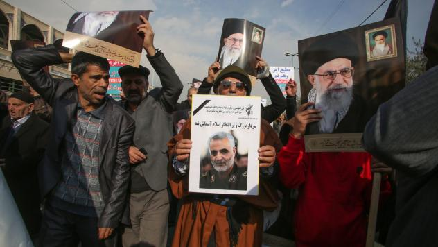 Iranian demonstrators hold posters of slain Maj. Gen. Qassem Soleimani (center) and the country's supreme leader, Ayatollah Ali Khamenei, during a rally Friday in the capital, Tehran. The U.S. strike on the military leader in Baghdad has elicited warning