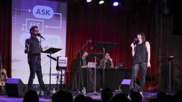 Ophira Eisenberg performs on stage alongside Jonathan Coulton on <em>Ask Me Another </em>at the Bell House in Brooklyn, New York.