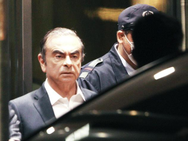 Former Nissan Chairman Carlos Ghosn, pictured leaving the Tokyo Detention Center in April, is believed to have escaped with the help of several individuals. So far, Turkish authorities have arrested 12 people in connection with the auto executive's getaw
