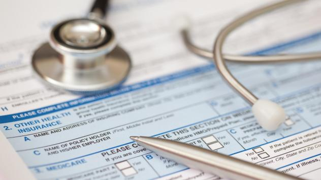 Patient health record form with stethoscope