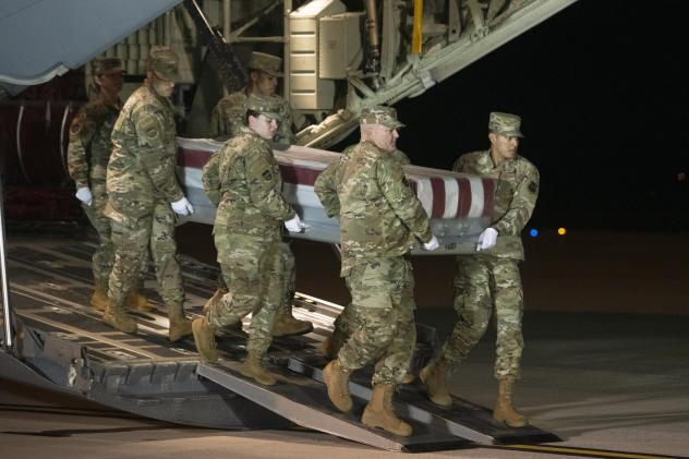 An Air Force team moves a transfer case containing the remains of one of the young sailors killed after a Saudi military student opened fire at Naval Air Station Pensacola last month. Officials are expected to soon announce that about 20 Saudi military s