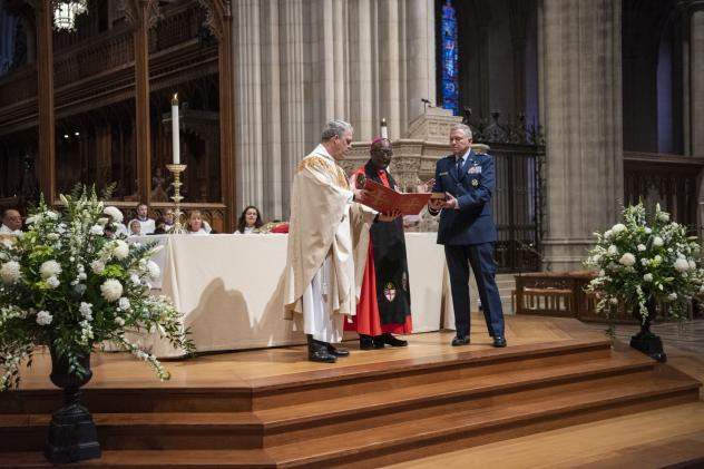 The Rev. Randolph Hollerith, dean of the Washington National Cathedral (from left); the Rev. Carl Wright, the Episcopal Church's bishop suffragan for the armed forces; and Maj. Gen. Steven Schaick, the Air Force chief of chaplains, participate in the ble