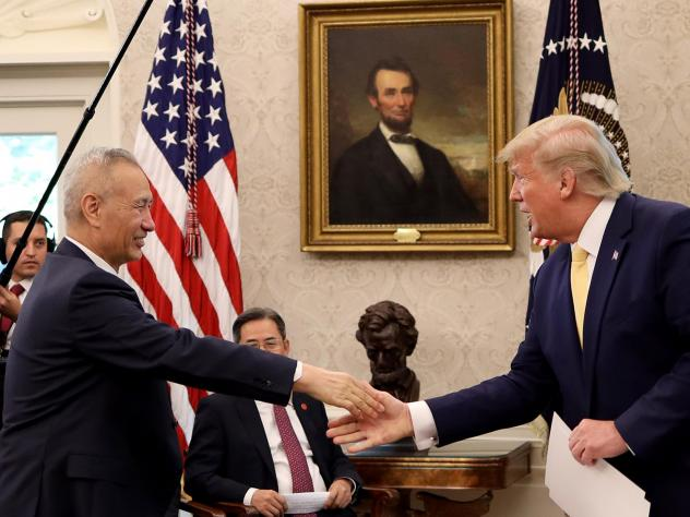 "President Trump shakes hands with Chinese Vice Premier Liu He at the White House after announcing a ""Phase 1"" trade agreement with China on Oct. 11. The two leaders are meeting again in Washington on Wednesday to sign the deal."