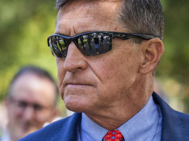 Michael Flynn, President Donald Trump's former national security adviser, leaves federal court following a status conference with U.S. District Judge Emmet Sullivan, in Washington, in September.