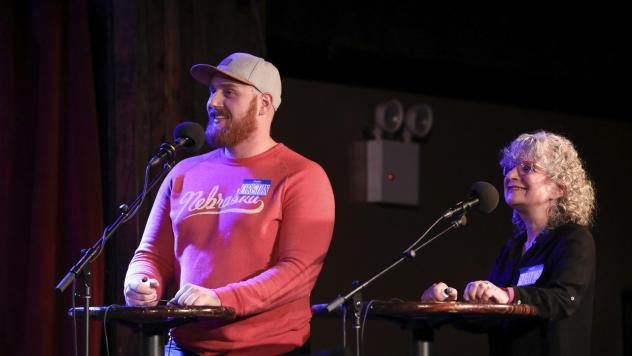 Contestants Christian Thomsen and Nancy Libow face off in a game on <em>Ask Me Another</em> at the Bell House in Brooklyn, New York.