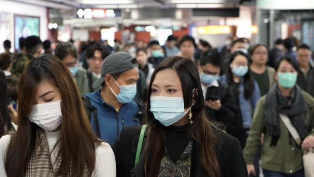 Passengers in a subway station in Hong Kong on Wednesday wear masks amid the coronavirus outbreak.