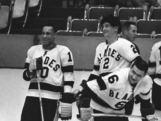 Willie O'Ree (left) and Howie Young (center) of the Los Angeles Blades talk during warm ups before their game at the Los Angeles Sports Arena during the 1963-64 season in Los Angeles, Calif. O'Ree became the first black player in the National Hockey Leag