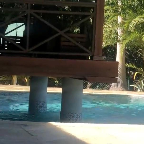 Waves splash in a pool during an earthquake, seen in a still frame from social media video, in George Town, Grand Cayman, Cayman Islands.