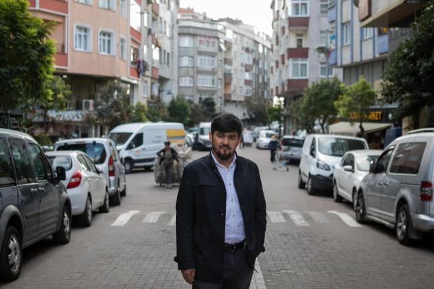 Uighur writer and poet Abdurehim Imin Parach stands in the Zeytinburnu neighborhood of Istanbul. He has been detained twice by Turkish authorities. NPR spoke to more than a dozen Uighurs in Istanbul who detailed how Turkish police arrested them and sent