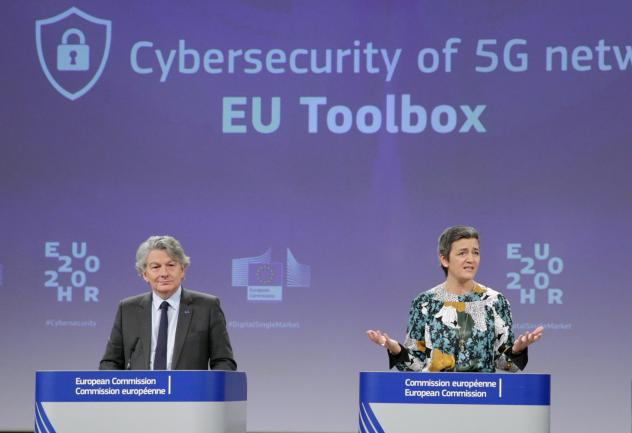 Two European Commission officials, Thierry Breton (left) and Margrethe Vestager (right), give a press conference on 5G security Wednesday in Brussels. The EU recommended that member states screen telecom firms, but did not call for banning any by name. T