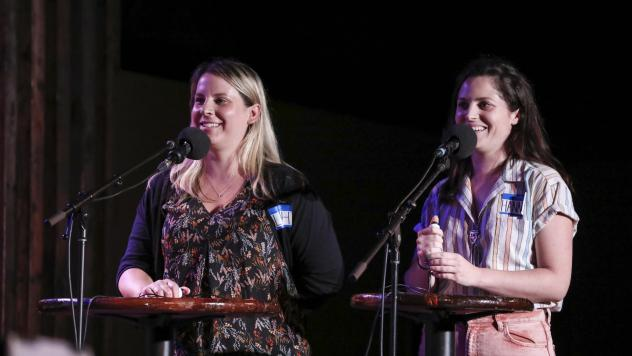 Contestants Leah Scrivner and Hannah Corrigan face-off in a game on <em>Ask Me Another</em> at the Bell House in Brooklyn, New York.