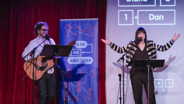 Jonathan Coulton leads a music parody game alongside Ophira Eisenberg on <em>Ask Me Another</em> at the Bell House in Brooklyn, New York.