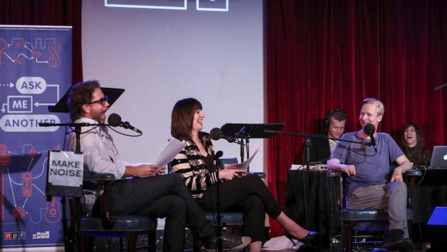 John Cameron Mitchell plays a game with Jonathan Coulton and Ophira Eisenberg on <em>Ask Me Another</em> at the Bell House in Brooklyn, New York.