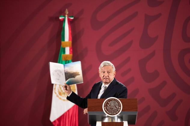 Mexican President Andrés Manuel López Obrador shows a brochure of the 787 Dreamliner belonging to the Mexican Presidency, during a news conference at the National Palace in Mexico City on Jan. 14.
