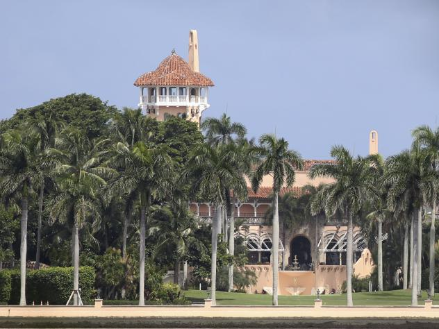 Authorities say a black SUV ran through two checkpoints at President Trump's Mar-a-Lago resort in Palm Beach, Fla.