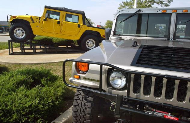 Hummer SUVs are displayed at a dealer in Schaumburg, Ill., in 2002.