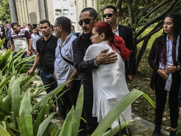 Manuel Gonzales, a FARC political leader and former FARC commander, hugs a friend at the funeral of his son, former FARC guerrilla Manuel Antonio Gonzalez, in Medellin, Colombia, in December. Gonzales was shot dead near the Territorial Area of Training a