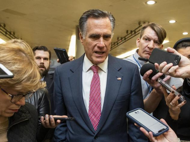 Sen. Mitt Romney, R-Utah, speaks to reporters as he arrives at the Capitol. On Wednesday, he became the first senator to vote to convict and remove a U.S. president of the same party.