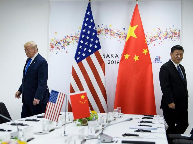President Trump and Chinese President Xi Jinping attend a bilateral meeting on the sidelines of the G20 Summit in Osaka last June. The two leaders spoke by phone earlier this month. Since the coronavirus outbreak, China has let in some experts from the W