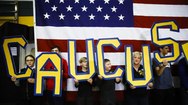 """Attendees hold letters that read """"CAUCUS"""" during a campaign event for Democratic presidential candidate former South Bend, Ind., Mayor Pete Buttigieg in Iowa earlier this month."""