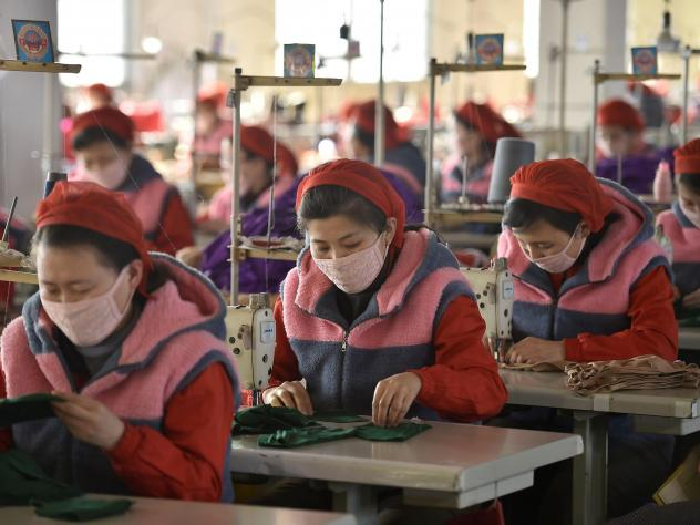 Workers in Pyongyang produce masks for protection against the new coronavirus. Experts say North Korea's track record of fighting epidemics does not bode well for its handling of the coronavirus outbreak.
