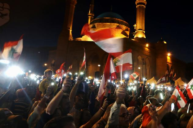 Lebanese anti-government protesters use the light on their mobile phones during a demonstration in downtown Beirut in November. Activists turned to social media platforms to get out their message, streaming protests live on Twitter and highlighting polic
