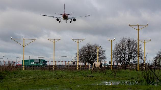An airplane arrives at London's Heathrow Airport on Thursday — the same day a court blocked plans for a third runway at the airport, citing the government's climate change commitments.
