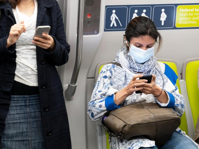 Health officials have identified what could be the first U.S. case of the novel coronavirus spreading within the general population. But a hospital says the diagnosis was delayed for days. Here, a passenger wears a face mask on a train in San Francisco o