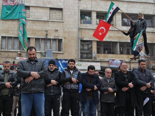 Syrians in the northwestern city of Idlib perform funerary prayers for Turkish soldiers Friday. Turkey sought an urgent NATO meeting after at least 33 Turkish soldiers were killed in Syria's Idlib province Thursday.