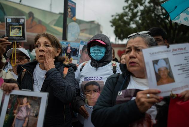 People who gathered in Poza Rico last month brought with them posters, T-shirts and jewelry bearing the images of their missing loved ones.