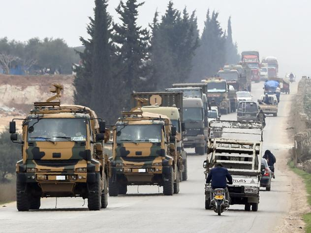 A Turkish military convoy drives in the east of Idlib on Feb. 28.