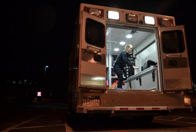 Emergency medical technician Justine Berry with Susquehanna Township EMS in Harrisburg, Pa., cleans an ambulance with antimicrobial wipes after a patient has been removed. EMS directors say more cleaning supplies and protective equipment will be vital if