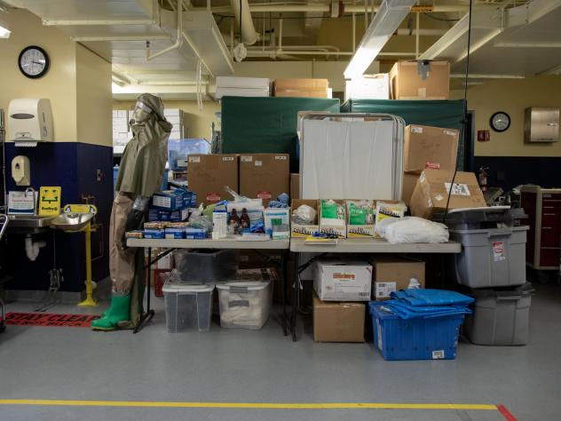 """MedStar Washington Hospital Center's """"ready room"""" in Washington, D.C., has mostly been used to house emergency supplies — but some storage carts have been moved out to make way for patient assessment stations."""