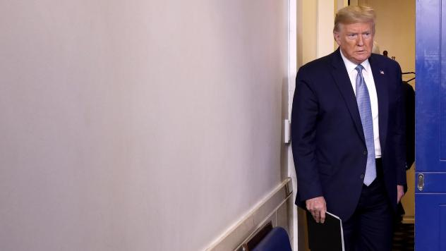 President Trump arrives in the press briefing room to speak about the coronavirus at the White House on Monday.