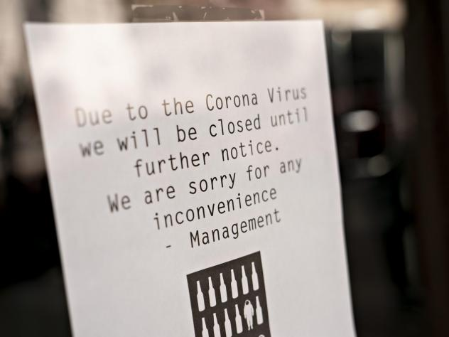 A sign at a bar in Washington, D.C., alerts customers that it's closed due to the coronavirus outbreak. Lawmakers are considering big moves to assist small businesses.