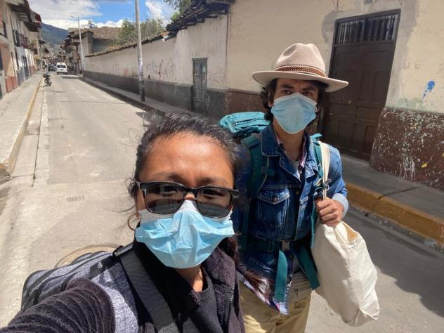 Pu Ying Huang (left) and Dylan Baddour walk along an empty street in Cajamarca, Peru, on March 18, while they were moving from a small hotel room to an Airbnb to ride out the country's 15-day lockdown.